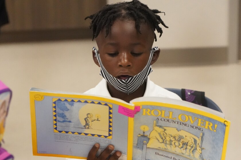 Taiden Watkins reads on first day of school in Florida.