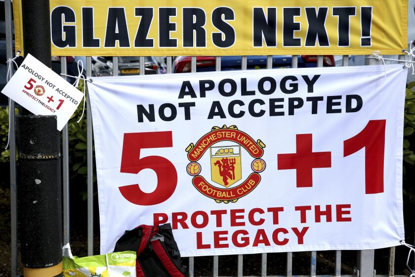 Banners near the stadium as fans protest against the Glazer family, owners of Manchester United, before their Premier League match against Liverpool at Old Trafford, Manchester, England, Sunday, May 2, 2021. (Barrington Coombs/PA via AP)