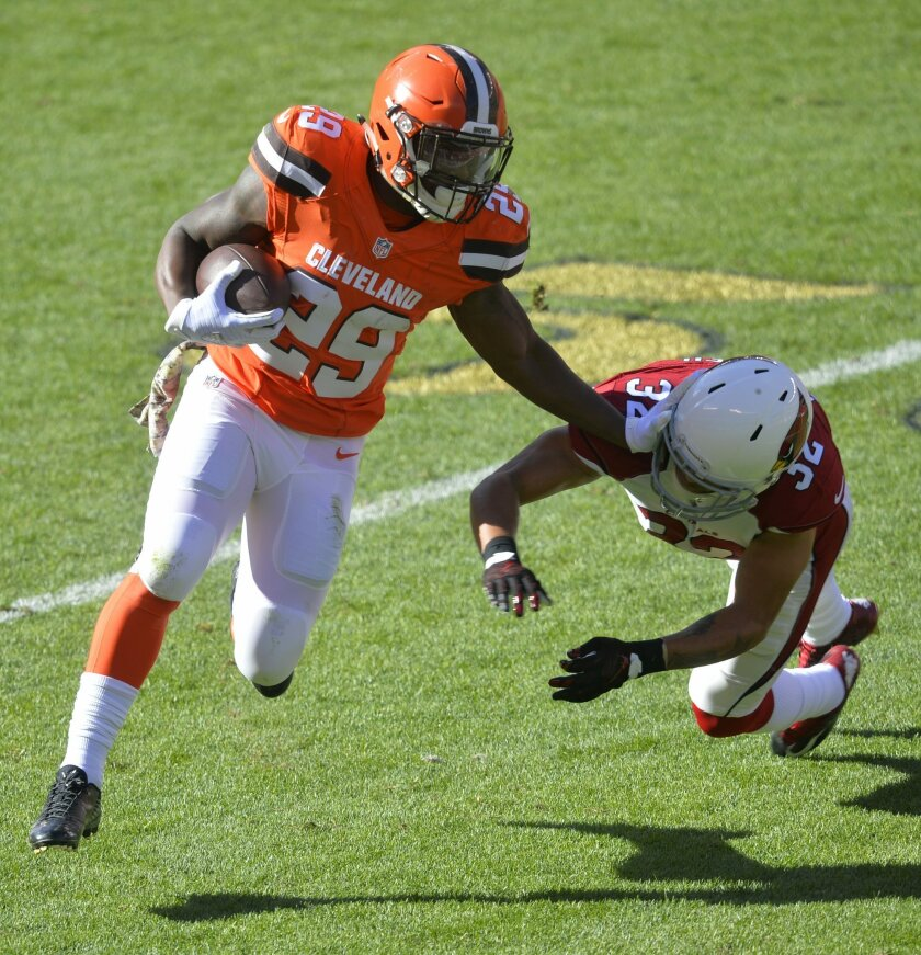 Cleveland Browns running back Duke Johnson (29) runs for a first down as Arizona Cardinals free safety Tyrann Mathieu (32) tries to make a tackle in the first half of an NFL football game, Sunday, Nov. 1, 2015, in Cleveland. (AP Photo/David Richard)