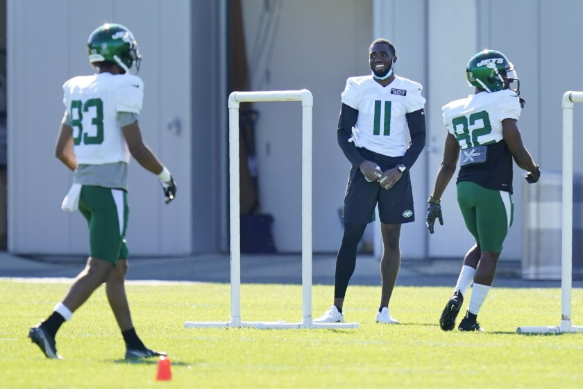 New York Jets' Denzel Mims (11) stand off to the side during a practice at the NFL football team's training camp in Florham Park, N.J., Thursday, Aug. 20, 2020. (AP Photo/Seth Wenig)