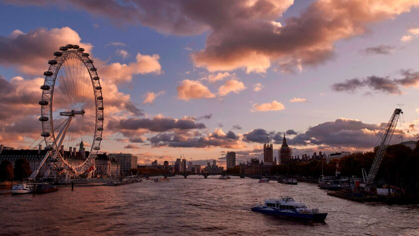 The London Eye, and the Houses of Parliament are pictured as the sun sets over River Thames. Cheapflightsfinder.com found a round-trip fare from San Francisco to London for $367.