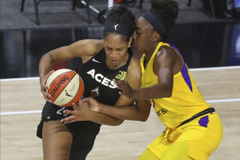 Aces center A'ja Wilson drives against Sparks forward Nneka Ogwumike during the first half of their game Sept. 12, 2020.
