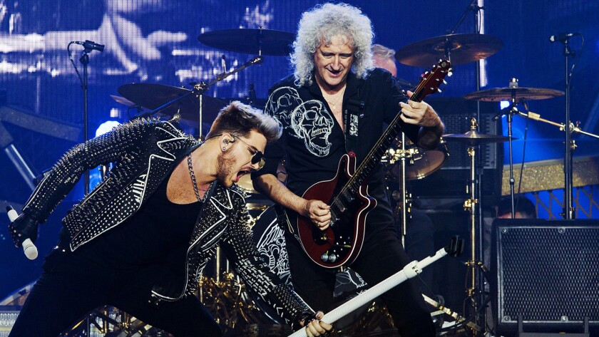 """Adam Lambert, left, and Brian May in """"The Show Must Go On: The Queen & Adam Lambert Story"""" on ABC."""