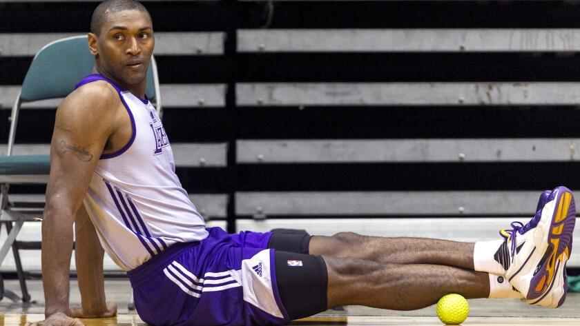 Lakers forward Metta World Peace stretches courtside during a practice in Hawaii.