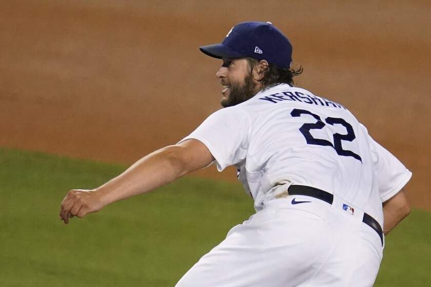 Los Angeles Dodgers starting pitcher Clayton Kershaw follows through on a pitch during the sixth inning of the team's baseball game against the Arizona Diamondbacks on Thursday, Sept. 3, 2020, in Los Angeles. (AP Photo/Marcio Jose Sanchez)