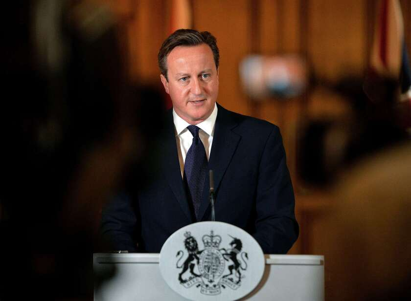 """British Prime Minister David Cameron delivers a statement in London on Sunday. """"We will do everything in our power to hunt down these murderers and ensure they face justice, however long it takes,"""" he said of the Islamic State militant group."""