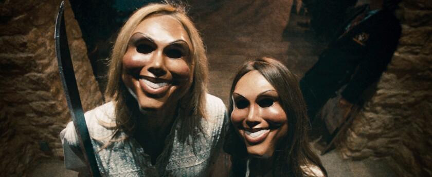 "Psychotic celebrants prepare to attack the Sandin family in ""The Purge."""