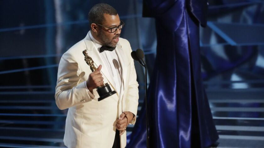 "Jordan Peele accepting his original screenplay Oscar for ""Get Out"" during the 90th Academy Awards on March 4, at the Dolby Theatre at Hollywood & Highland Center in Los Angeles."