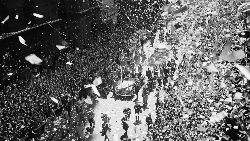 A blizzard of ticker tape and confetti virtually blots out the scene on lower Broadway as New Yorkers welcome Gen. Douglas MacArthur on April 20, 1951.