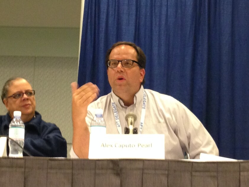 L.A. teachers union leader Alex Caputo-Pearl has told members to get ready for a possible strike. Chicago teachers union leader Karen Lewis sits to his right at the weekend convention.