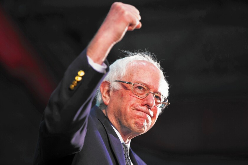 Democratic presidential candidate Sen. Bernie Sanders, I-Vt., raises his fist in the air during a campaign rally at Milton High School in Milton, Mass., on Feb. 29, 2016.