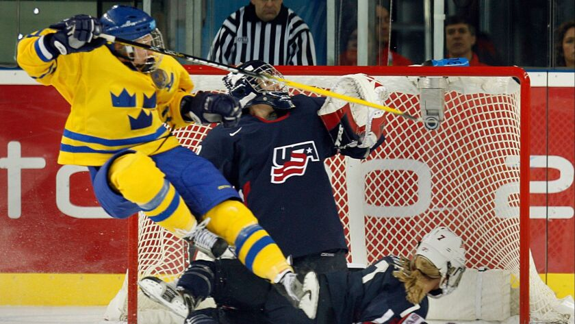 Sweden's Maria Rooth is upended as she scores the tying goal against the US women's hockey team in the second period at the Winter Olympic Games in Turin, Italy on Feb. 17, 2006.