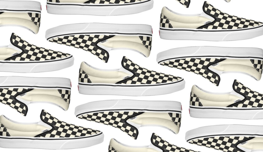 A photo of a slip-on sneaker with a black-and-white checkerboard pattern.