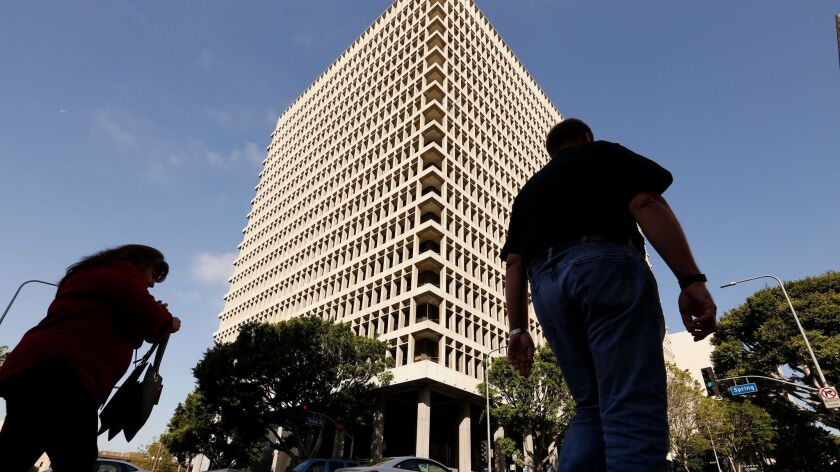 L.A. County supervisors voted to end the practice of charging a $50 registration fee to criminal defendants seeking representation by a public defender or court-appointed counsel. Above, the Clara Shortridge Foltz Criminal Justice Center.