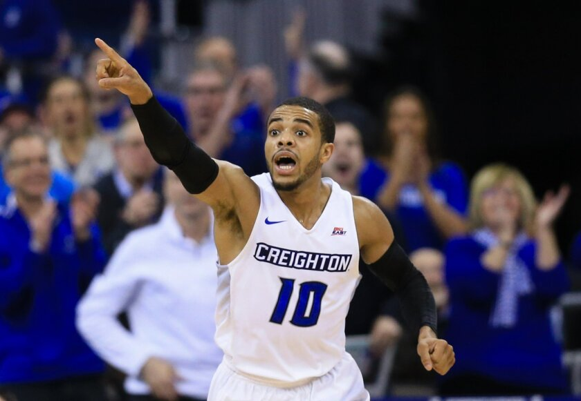 FILE - In this Tuesday, Feb. 9, 2016, file photo, Creighton's Maurice Watson Jr. (10) reacts after scoring during the second half of an NCAA college basketball game against Xavier in Omaha, Neb. Creighton is getting everything it could have hoped for and more from new Watson, whose career-high 32 p