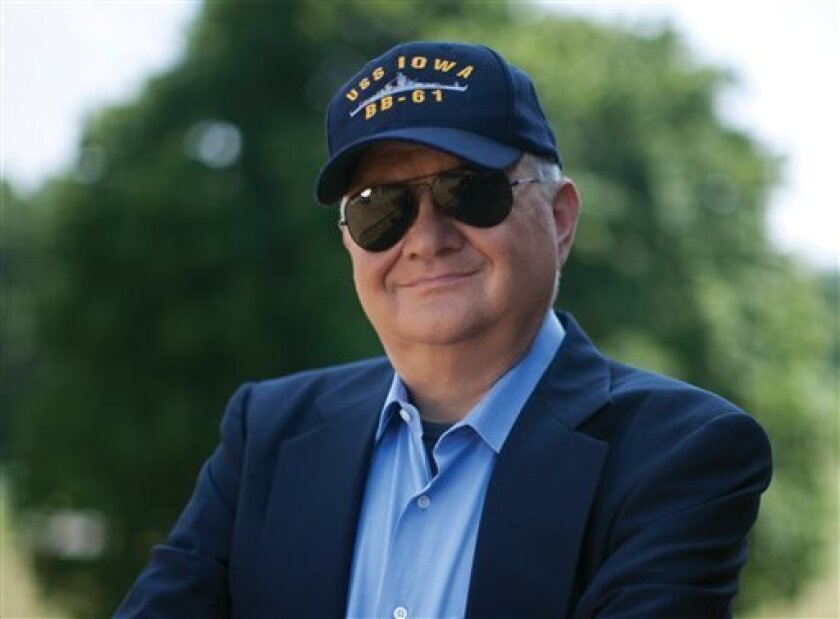 """This 2010 image released by G.P. Putnam Sons shows author Tom Clancy in Huntingtown, Md. Clancy, the bestselling author of """"The Hunt for Red October"""" and other wildly successful technological thrillers, has died. He was 66. Penguin Group (USA) said Wednesday that Clancy died Tuesday in Baltimore. T"""