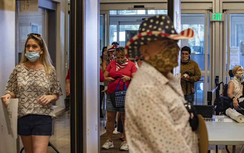 Spectators enter the Riverside County Administrative Center during the Board of Supervisors meeting on May 5.