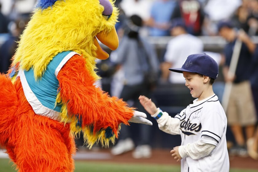 Make-A-Wish Foundation recipient seven-year-old Dominic Schalk is all smiles as he meets the San Diego Chicken before a May 28 game between the Padres and Pittsburgh Pirates at Petco Park. (AP Photo/Don Boomer)