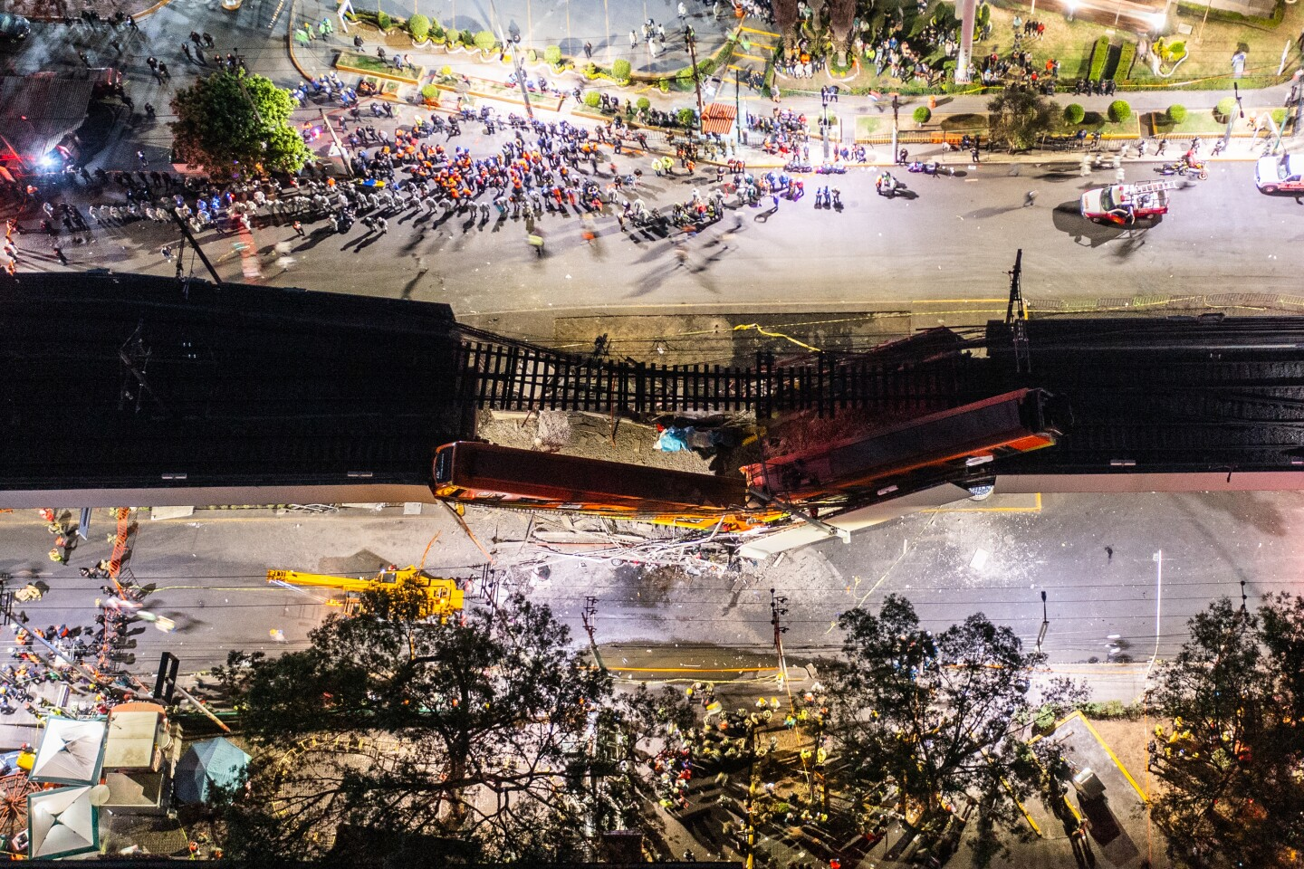 MEXICO CITY, MEXICO - MAY 03: An aerial view of the scene after an elevated section of metro track in Mexico City, carrying train cars with passengers, collapsed onto a busy road on May 03, 2021 in Mexico City, Mexico. The Line 12 accident happened as the metro train was traveling between Olivos and Tezonco Metro stations, reportedly killing at least 20 people and injuring further 70. (Photo by Hector Vivas/Getty Images)
