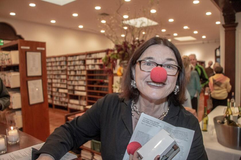 Athenaeum Music & Arts Library executive director Erika Torri, with a clown nose