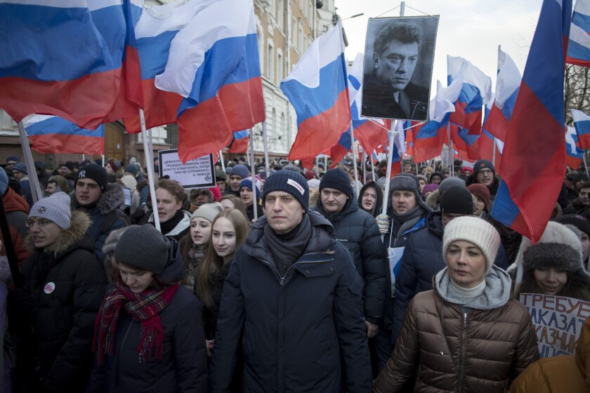 Russian opposition leader Alexei Navalny, centre, attends a rally in memory of opposition leader Boris Nemtsov, in Moscow, Russia, Sunday, Feb. 25, 2018.