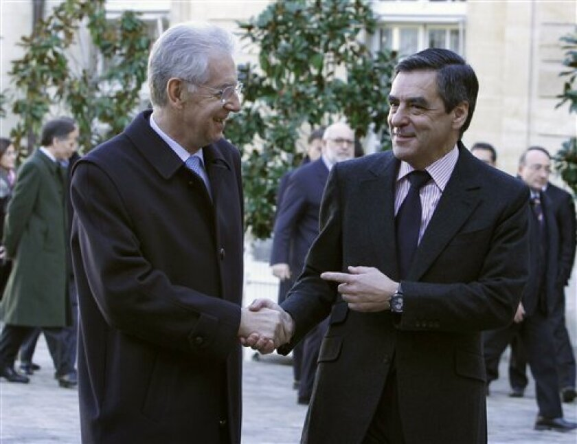 French prime minister Francois Fillon, right, greets his Italian counterpart Mario Monti prior to their meeting at the Hotel Matignon in Paris, Friday Jan. 6, 2012 (AP Photo/Remy de la Mauviniere)