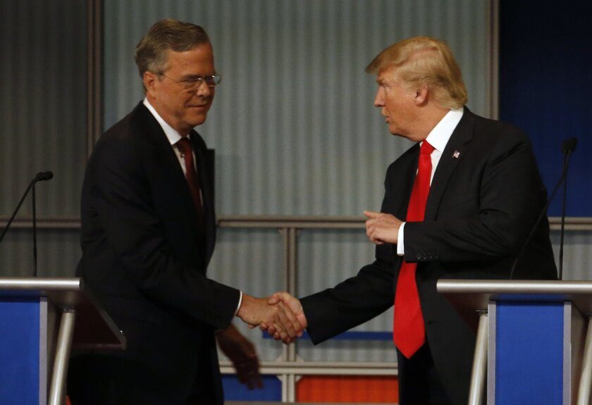 Jeb Bush and Donald Trump shake hands after the Republican presidential debate at the Milwaukee Theatre, Tuesday, Nov. 10, 2015, in Milwaukee. (AP Photo/Morry Gash)