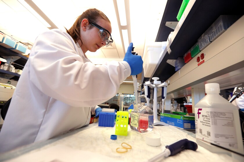 Kasey Jackson, a postdoctoral fellow, preps samples for analysis at Sanofi Genzyme in Framingham, Mass., in June 2017.