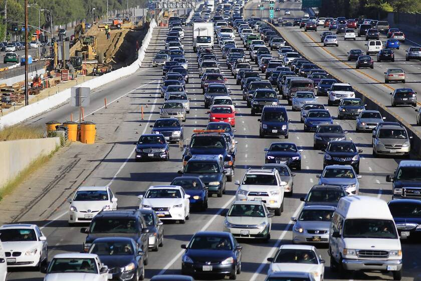 Traffic crawls along the northbound 405 Freeway in Westwood. The Los Angeles County Metropolitan Transportation Authority has said the construction project will take at least a year longer than originally planned.