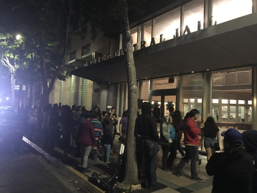 Protesters marched Thursday night outside the downtown San Diego Central Jail to demand the release of two people arrested earlier in the evening at Chicano Park in Barrio Logan.