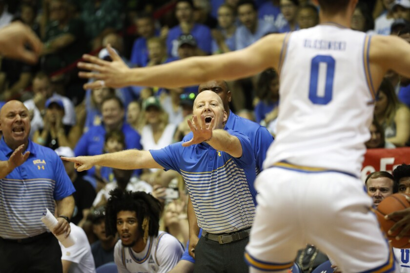 Mick Cronin coaches the Bruins against Michigan State on Nov. 27 in Lahaina, Hawaii.