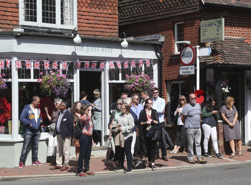 People begin to gather in Ditchling, England, ahead of the funeral for Forces Sweetheart Dame Vera Lynn, Friday July 10, 2020. The adored singer, who entertained troops with morale-boosting visits to the front line during the Second World War, died aged 103 on June 18. (Gareth Fuller/PA via AP)