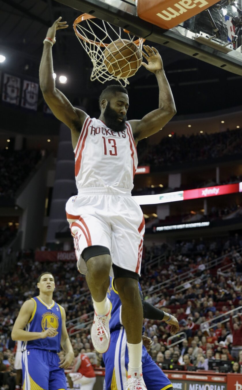Houston Rockets' James Harden (13) dunks the ball against the Golden State Warriors during the fourth quarter of an NBA basketball game Friday, Dec. 6, 2013, in Houston. The Rockets won 105-83. (AP Photo/David J. Phillip)