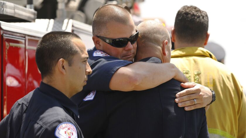 LONG BEACH, CA - JUNE 25, 2018: Long Beach Firefighter Demetropolis, left, hugs fellow Long Beach fi