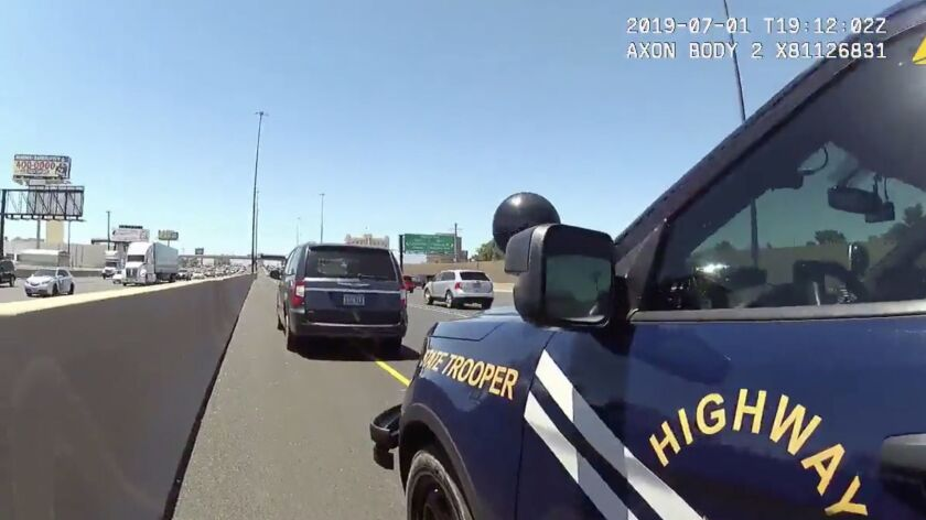 Body cam footage from a Nevada Highway Patrol Trooper Travis Smaka shows his view as he approaches a