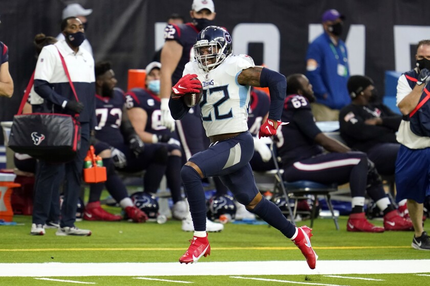 Tennessee Titans running back Derrick Henry (22) runs for a first down against the Houston Texans during the second half of an NFL football game Sunday, Jan. 3, 2021, in Houston. (AP Photo/Sam Craft)