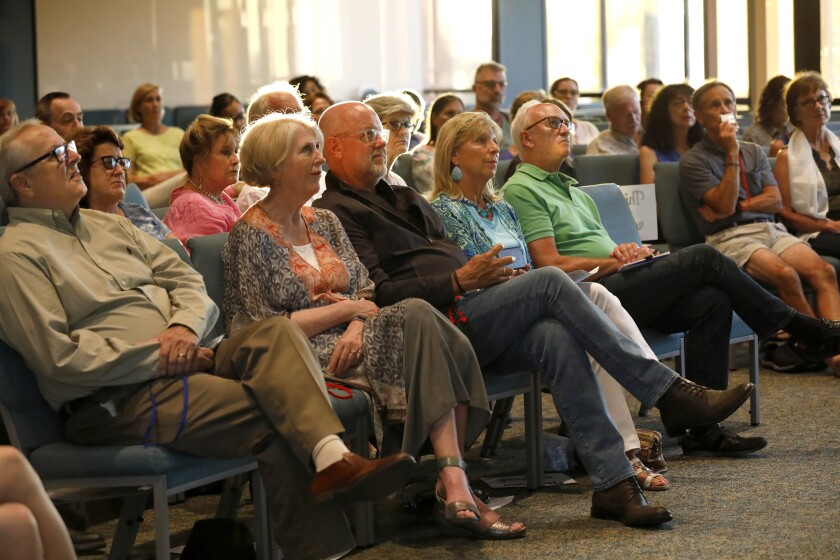 "A mostly-white audience at The Unity Center listens to dialogue expert David Campt talk about how to be a ""white ally"" in the fight against racism."