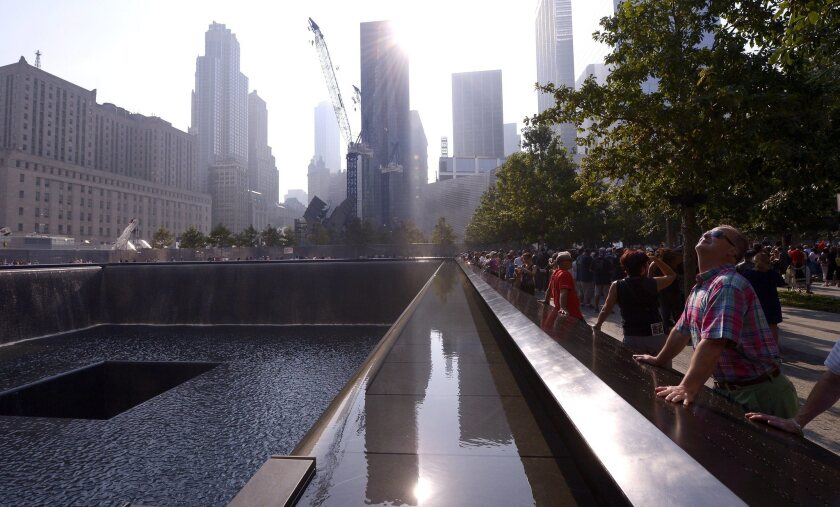 Visitors at the North Pool of the 9/11 Memorial during a ceremony marking the 12th anniversary of the 9/11 attacks on the World Trade Center in New York City.