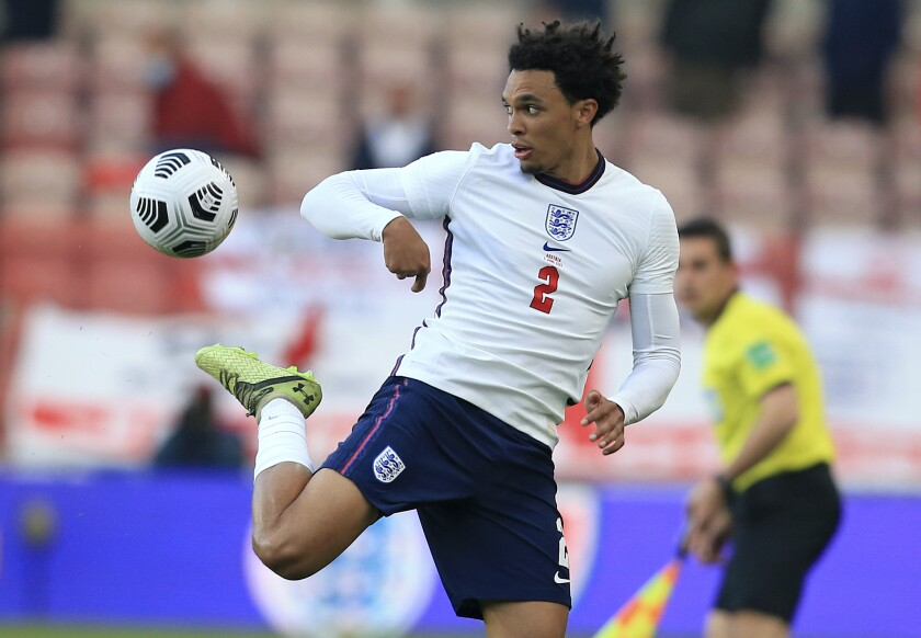 In this file photo dated Wednesday June 2, 2021, England's Trent Alexander-Arnold controls the ball during the international friendly soccer match against Austria at the Riverside stadium in Middlesbrough, England. Liverpool fullback Trent Alexander-Arnold has signed a contract extension to stay with his boyhood club though the 2024-25 season, it is announced Friday July 30, 2021. (Lindsey Parnaby, Pool FILE via AP)