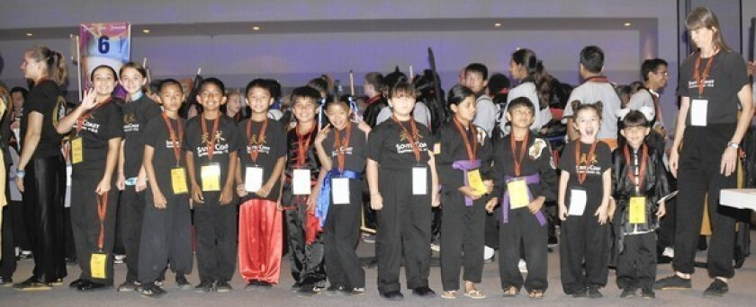 Twenty students from South Coast Martial Arts in Costa Mesa won 14 gold, five silver and six bronze medals at a contest hosted by the Shaolin Temple of China at the at the Los Angeles Convention Center.