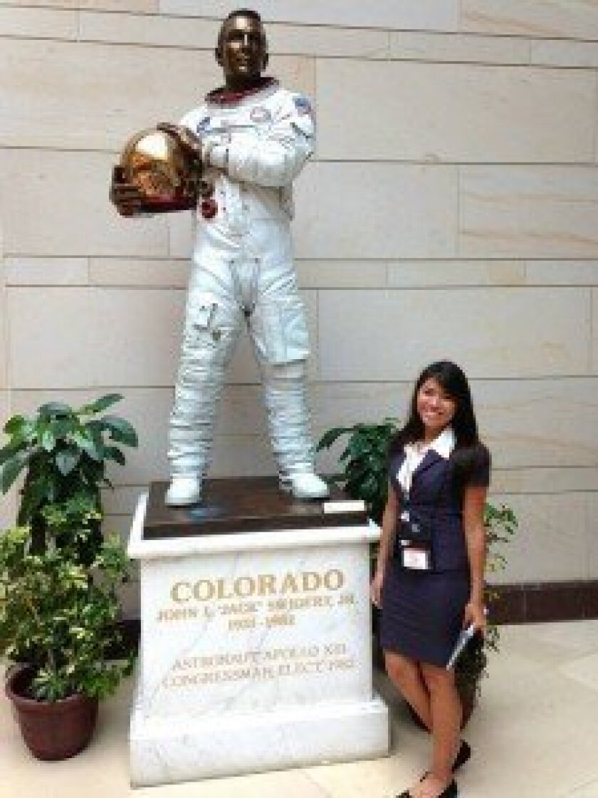 Flores with a statue of NASA astronaut Jack Swigert inside the U.S. Capitol Visitor Center. Swigert died of cancer eight days before he was to begin a term in Congress. 'I really admire astronauts and their bravery,' Daisy said. Courtesy photos
