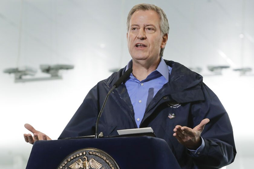 Mayor Bill de Blasio issued a series of controversial tweets Tuesday after he went to Brooklyn to oversee the dispersal of thousands of people who crowded the streets of Williamsburg for the funeral of a rabbi.