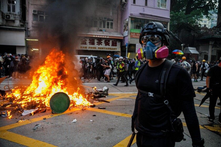 Pro-democracy demonstrators in Hong Kong retreat as police advance.