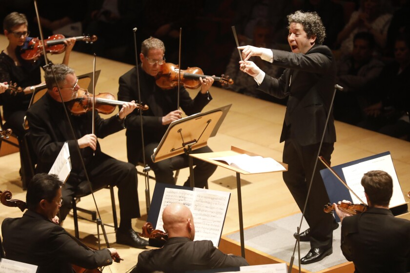 Gustavo Dudamel conducting the Los Angeles Philharmonic on stage at Walt Disney Concert Hall.