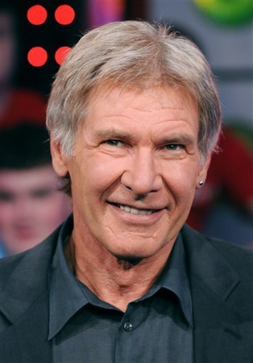"""In this May 20, 2008 file photo, actor Harrison Ford appears onstage during MTV's """"Total Request Live"""" show at the MTV Times Square Studios to promote his new movie """"Indiana Jones and The Kingdom of The Crystal Skull"""" in New York. (AP Photo/Peter Kramer, file)"""