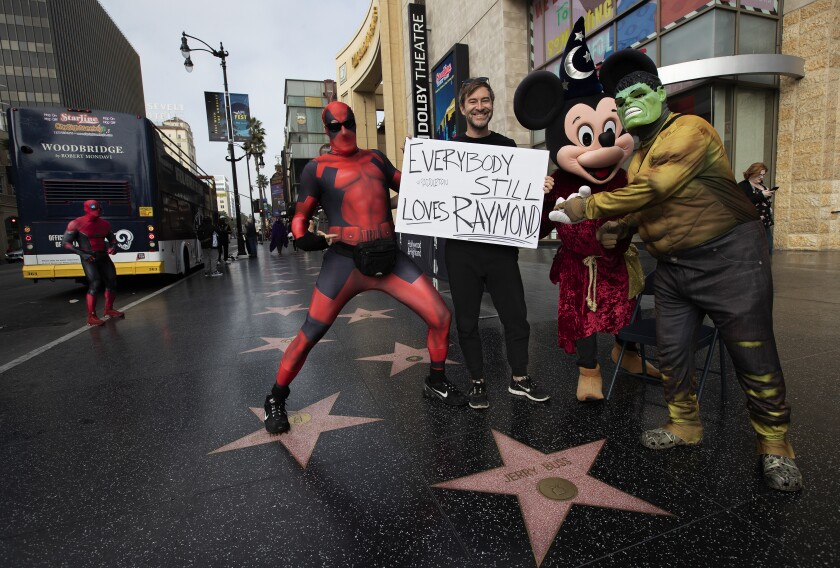 Mark Duplass stands with characters on Hollywood Boulevard.