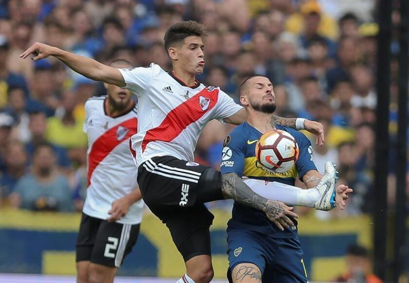 Player Dario Benedetto (R) of Boca Juniros disputes the ball with Exequiel Palacios (L) of River Plate during the first match of the Copa Libertadores final between Boca Juniors and River Plate, at La Bombonera stadium in Buenos Aires, Argentina. Nov. 11, 2018. EPA-EFE/Juan Ignacio Roncoroni/FILE