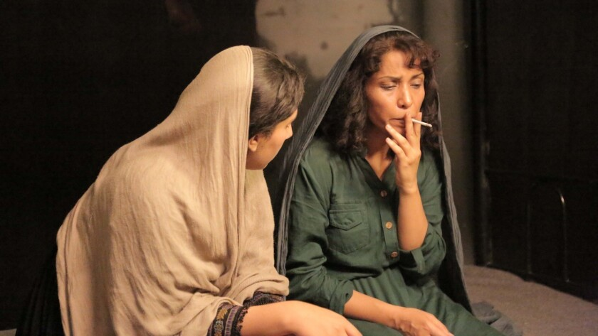 "Leena Alam (right) as the jailed feminist Soraya in ""A Letter to the President"", a new Afghan film b"