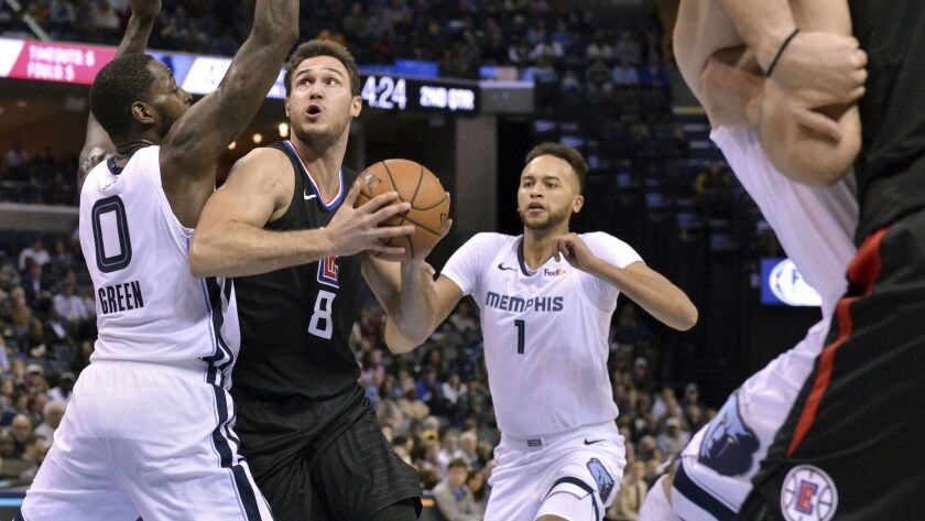 Clippers forward Danilo Gallinari (8) drives between Memphis Grizzlies forwards JaMychal Green (0) and Kyle Anderson (1) in the first half.