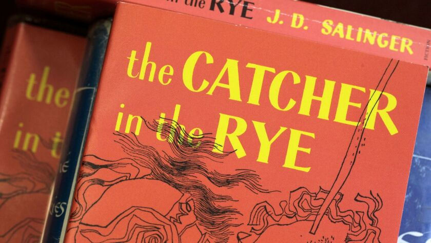 """FILE – In this Jan. 28, 2010 file photo, copies of J.D. Salinger's classic novel """"The Catcher in the"""